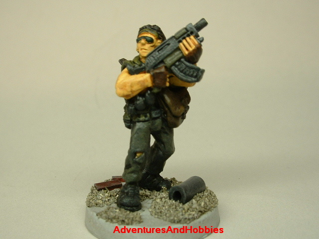 Post apocalypse soldier survivor with SMG 25mm painted figure for role-playing games and table top war games front view