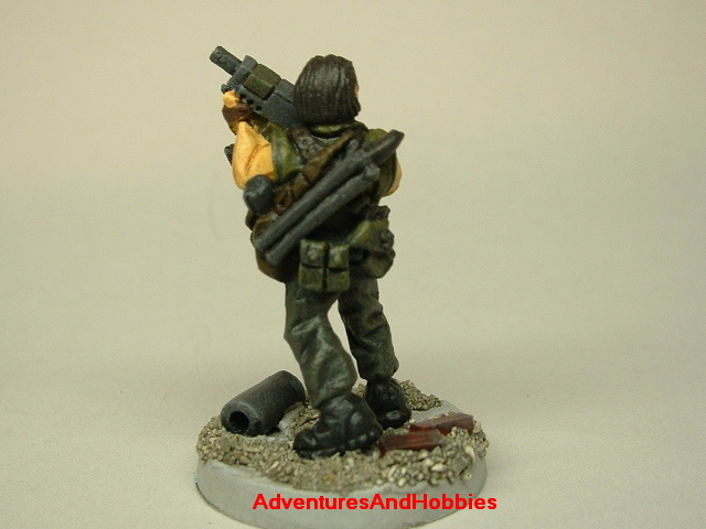 Post apocalypse soldier survivor with SMG 25mm painted figure for role-playing games and table top war games rear view