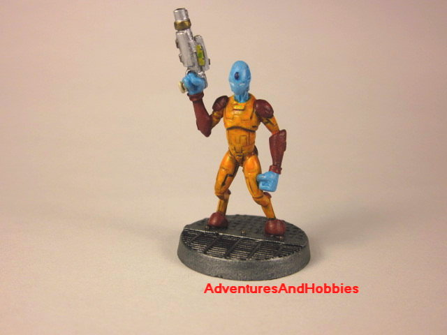 Alien warrior with handgun painted 25 mm figure for science fiction role-playing games and table top war games front view