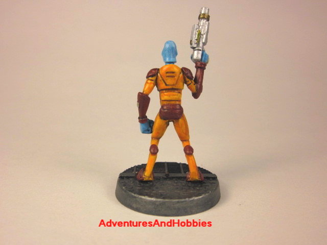 Alien warrior with handgun painted 25 mm figure for science fiction role-playing games and table top war games rear view