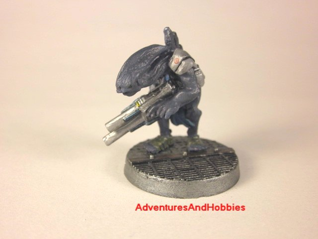 Alien warrior with pulse rifle painted 25 mm figure for science fiction role-playing games and table top war games front view