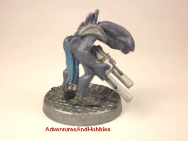 Alien warrior with pulse rifle painted 25 mm figure for science fiction role-playing games and table top war games rear view
