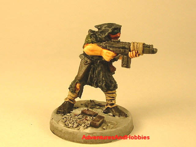 Post apocalypse soldier with assault rifle 25 mm painted figure for role-playing games and table top war games front view