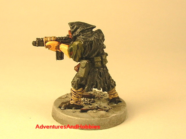 Post apocalypse soldier with assault rifle 25 mm painted figure for role-playing games and table top war games rear view