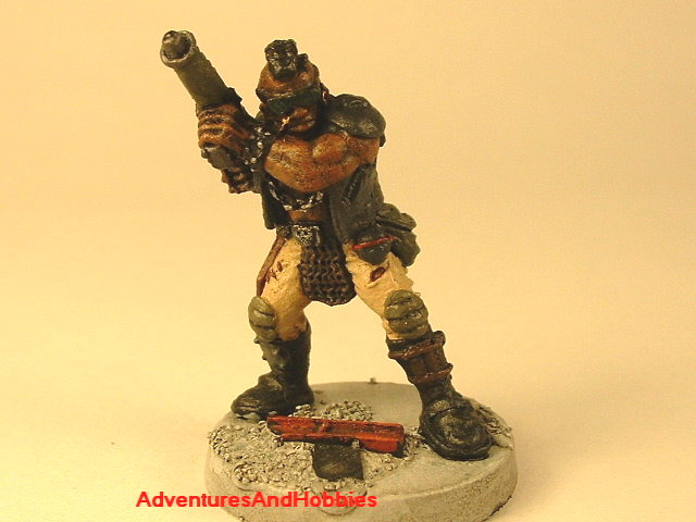 Post apocalypse soldier with assault rifle and armor 25 mm painted figure for role-playing games and table top war games front view