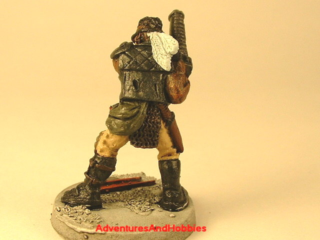 Post apocalypse soldier with assault rifle and armor 25 mm painted figure for role-playing games and table top war games rear view