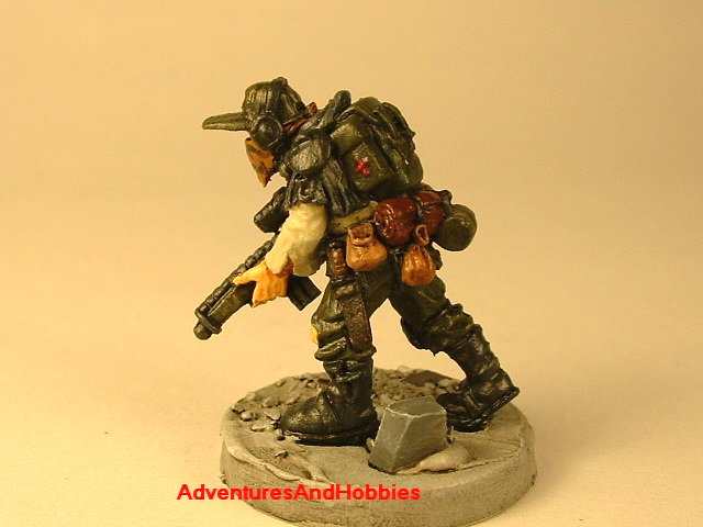 Post apocalypse soldier with sniper rifle 25 mm painted figure for role-playing games and table top war games rear view