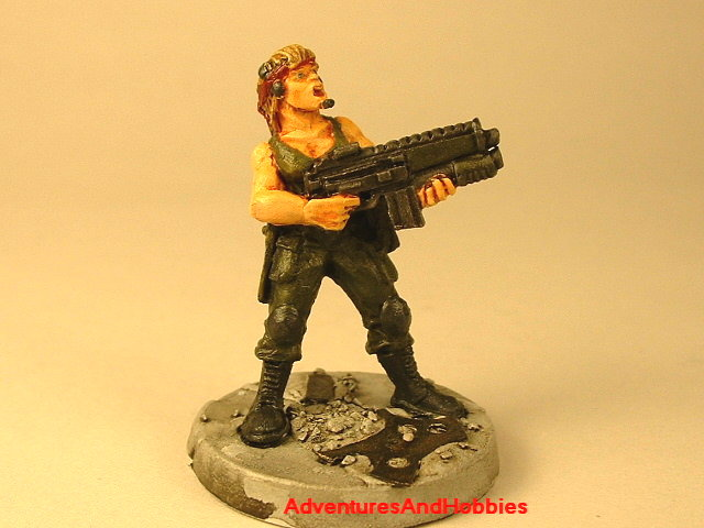 Post apocalypse female soldier with assault rifle and grenade launcher 25 mm painted figure for role-playing games and table top war games front view