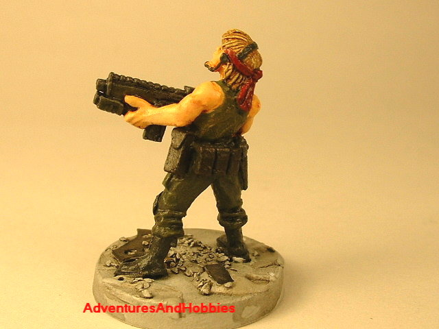 Post apocalypse female soldier with assault rifle and grenade launcher 25 mm painted figure for role-playing games and table top war games rear view