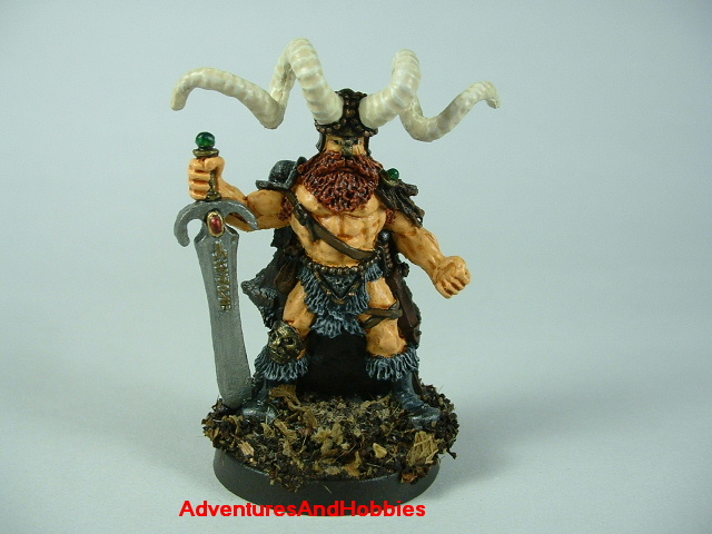 Barbarian chief fighter with broadsword and horned helmet painted figure for fantasy role-playing games and table top war games - front view