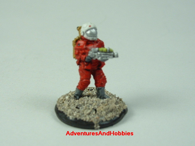 Space marine in vac suit with energy rifle 15 mm painted figure for science fiction role-playing games and table top war games front view