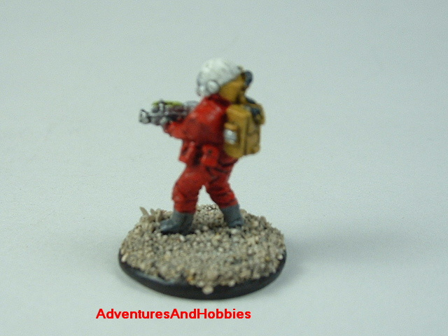 Space marine in vac suit with energy rifle 15 mm painted figure for science fiction role-playing games and table top war games rear view