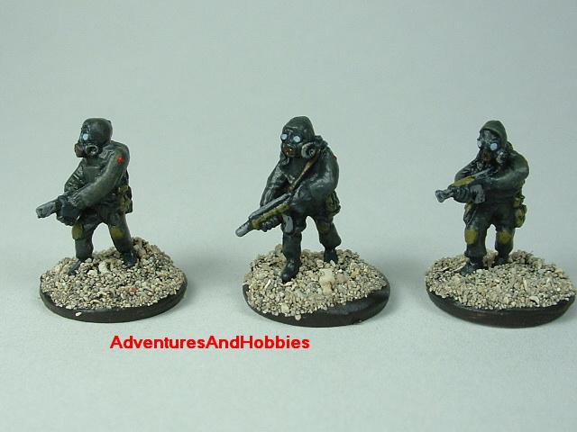 Three-man Fire Team A in bio suits painted 15 mm scale figure for modern or post apocalypse role-playing games and table top war games - front view