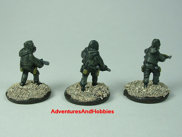 Three-man Fire Team A in bio suits painted 15 mm scale figure for modern or post apocalypse role-playing games and table top war games - rear view