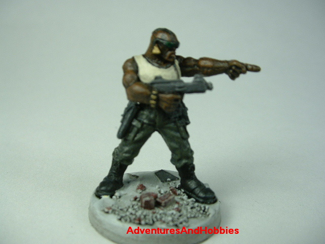 Post apocalypse soldier zombie hunter with submachinegun painted figure for role-playing games and table top war games - front view