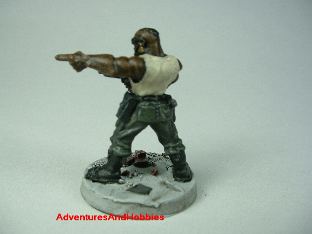 Post apocalypse soldier zombie hunter with submachinegun painted figure for role-playing games and table top war games - rear view