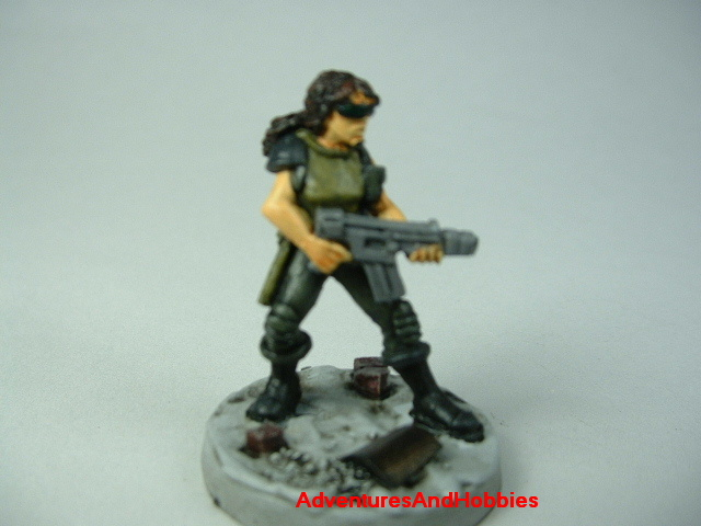 Post apocalypse female soldier zombie hunter with miltary assault rifle painted figure for role-playing games and table top war games - front view