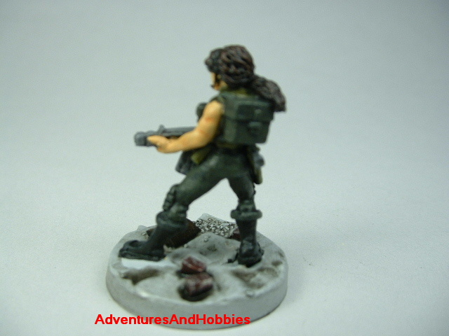 Post apocalypse female soldier zombie hunter with miltary assault rifle painted figure for role-playing games and table top war games - rear view
