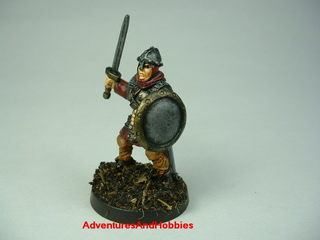 Man at arms with sword painted figure for fantasy role-playing games and table top war games - side view
