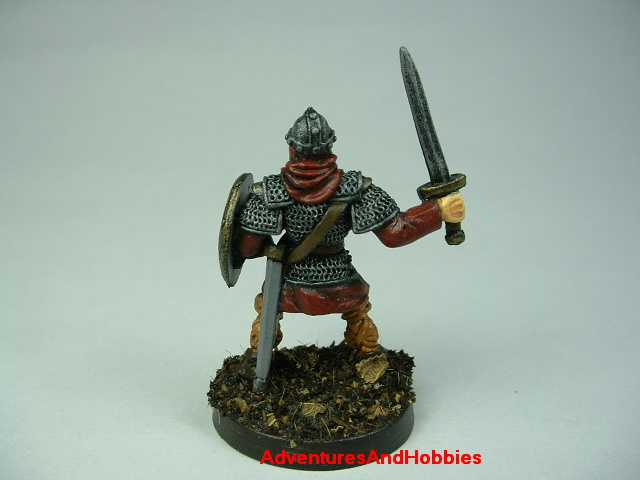 Man at arms with sword painted figure for fantasy role-playing games and table top war games - rear view