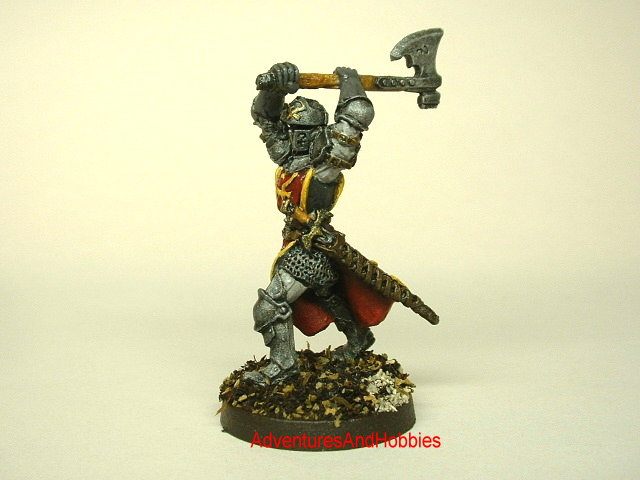 Knight in platemail attacking with two handed battle axe painted 25mm fantasy war game miniature