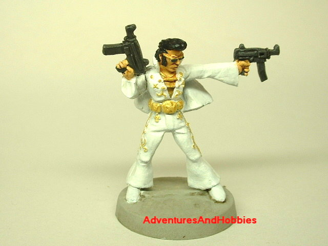 Elvis King of Rock and Roll Zombie Hunter 25 mm painted miniature fugure for war games and role-playing games front view.