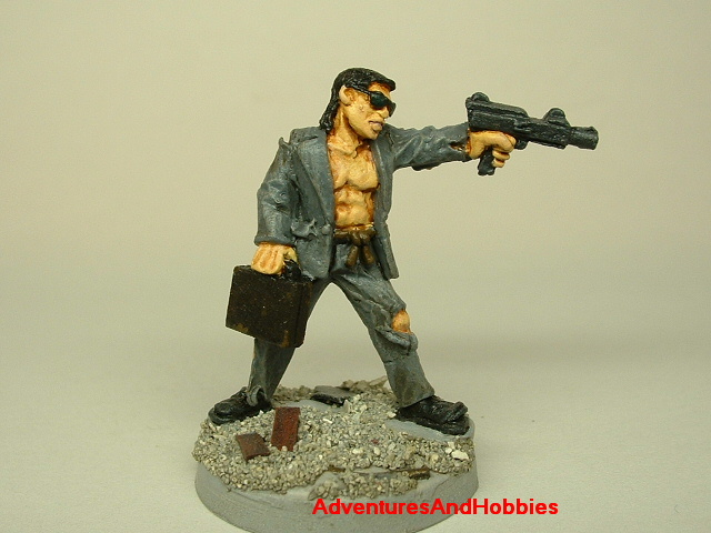Post apocalypse survivor in ragged suit and machine gun painted figure for role-playing games and table top war games front view