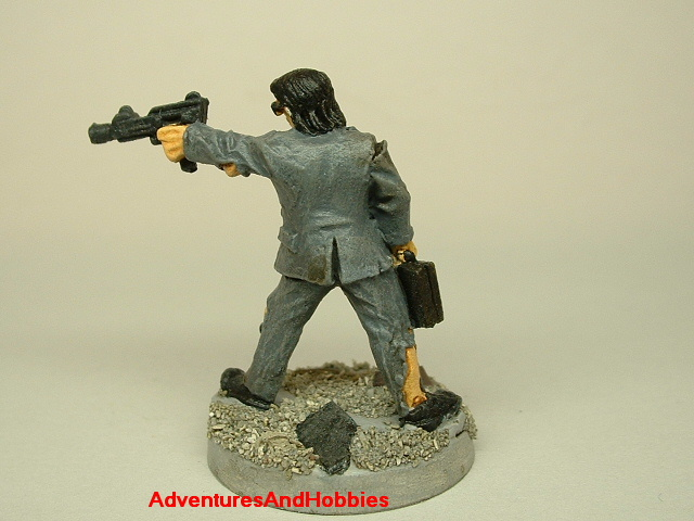 Post apocalypse survivor in ragged suit and machine gun painted figure for role-playing games and table top war games rear view