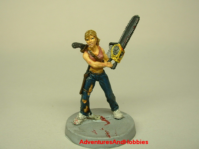 Zombie survivor woman with chainsaw painted figure for role-playing games and table top war games front view