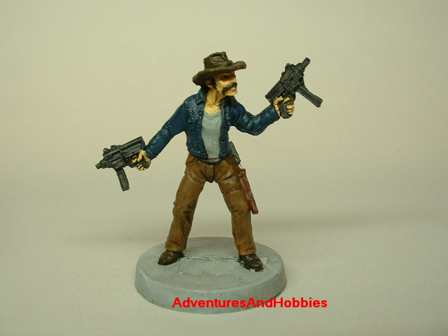 Zombie survivor with sub-machine guns painted figure for role-playing games and table top war games front view