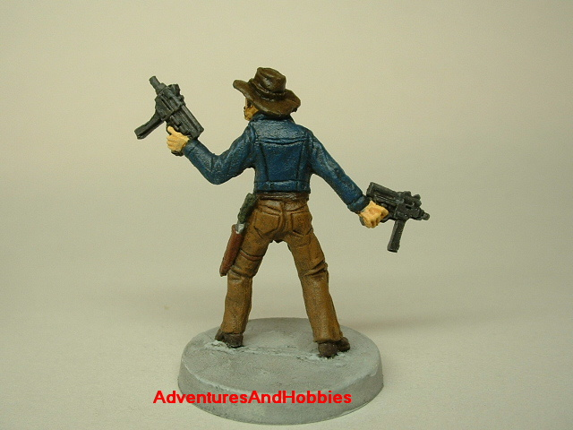 Zombie survivor with sub-machine guns painted figure for role-playing games and table top war games rear view