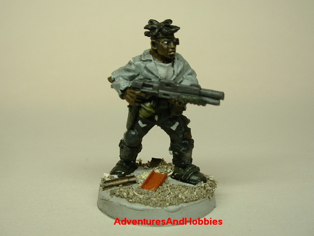 Post apocalypse zombie survivor male civilian warrior painted figure for role-playing games and table top war games front view.