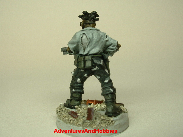 Post apocalypse zombie survivor male civilian warrior painted figure for role-playing games and table top war games rear view.