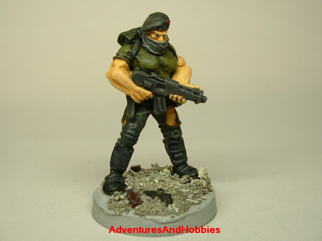 Post apocalypse zombie survivor soldier painted figure for role-playing games and table top war games front view.