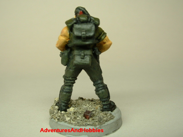 Post apocalypse zombie survivor soldier painted figure for role-playing games and table top war games rear view.