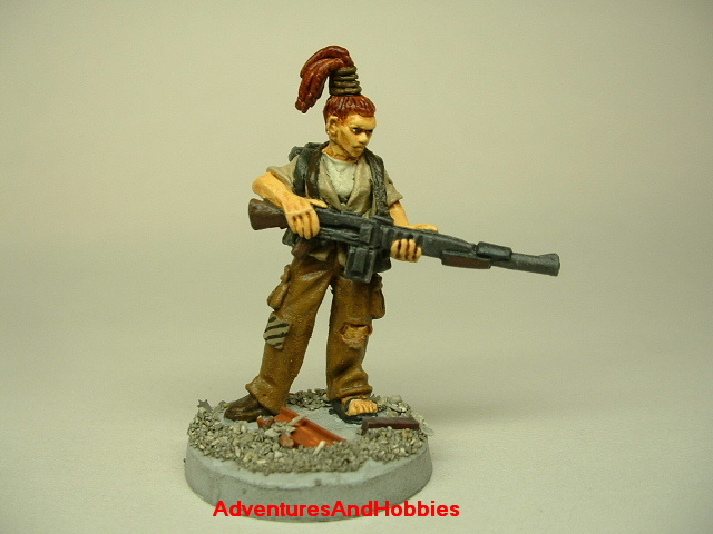 Post apocalypse zombie survivor female warrior painted figure for role-playing games and table top war games front view.