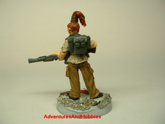 Post apocalypse zombie survivor female warrior painted figure for role-playing games and table top war games rear view.