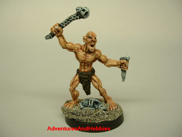 Ghoul attacking with bone weapons painted figure for horror and fantasy role-playing games and table top war games front view